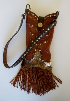 Our boots have a new way of walking:  this is a single bag created from  vintage cowboy boot, one of a kind, hand crafted. www.stagecoachbagsandcollectibles.com Crafts To Do, Boho Outfits, Cowboy Boots, Boho Chic, Purses And Bags, Totes, Upcycle, Quilting, Walking
