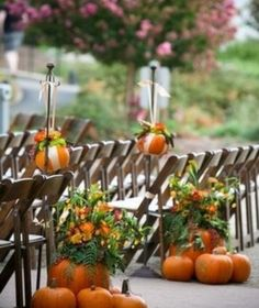 Love the pumpkins and flowers at the end, but lanterns hanging from the hooks??