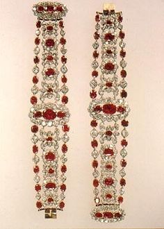 These Bracelets were also part of a large parure belonging to Marie~Therese. It consisted of a coronet topped by an eagle, a tiara, comb, girandole earrings, belt buckle, and the two bracelets. It was one of the crown jewels of France that came from the collection founded in 1530 by Francois I. Marie~Louise wore these jewels on her wedding day and after the fall of the Empire and the restoration of the Bourbon Monarchy they went to Marie~Therese. She was the last Royal to enjoy these Rubies.