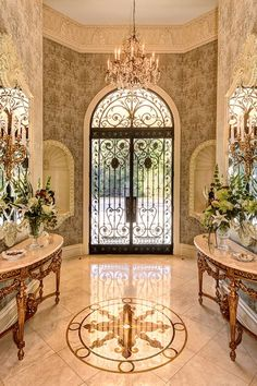 Traditional Entryway with Transom window, simple marble tile floors, interior wallpaper, French doors, High ceiling