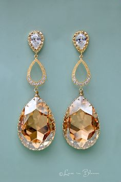 These Wedding earrings are a glamorous and eye catching golden chandelier design. By Luxe in Bloom