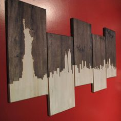 Beautiful multi piece New York City skyline. Each individual piece is 9.25x19 and all 5 together cover approximately a 47x30 area.  Little Rhody Crafts