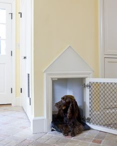 A built-in dog crate. - cut drywall the size you  need for your pet - line inside space with drywall, paint. Frame outside with molding and add 2 strips of decorative molding to form triangular pediment, paint molding
