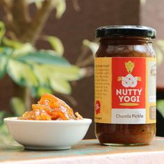 Product Description: The Nutty Yogi Chunda Pickle is a classic. A Gujarati sweet and sour mango pickle that is made with combining grated raw mangoes with sweetness and tanginess of spices. A favourite with kids and adults, it's a must-have with anything and everything.Q Factor: Authentic Gujarati chunda with the notes of sweetness.  Jar Quantity: Single jar  Q Factor: Authentic Gujrati chunda with the notes of sweetness.