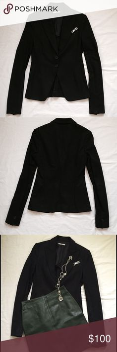 Ilsli Black Zipper Blazer Ilsli fitted Zipper blazer in black. Composed of 100% cotton with a partial lining of 93% polyester, 7% spandex. Silvertone zipper on upper left functions, but the pocket does not (is shallow),  Please note: although a Size 6, the jacket is fitted and meant to fit closely.  The arms are a tighter fit and longer than average. Very well made -- has the feel of a fine knit corduroy -- and in the USA. Dry clean only. Ilsli Jackets & Coats Blazers