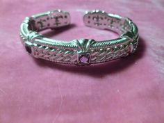 Sterling silver and amethyst judith ripka cuff bracelet 7 / 7.5 inch width previously worn but in very good vintage condition. You have 7 days to file a complaint if item is not as described.