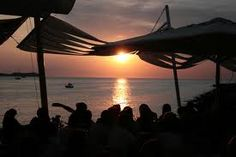 The white island of Ibiza is world famous for its late night parties, exclusive clubbing culture and hedonistic fun. World Famous, Outdoor Furniture, Outdoor Decor, Ibiza, Hammock, Island, Explore, Sunset, Night