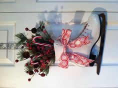 Ice skate door decoration for Christmas... So sentimental when it was the same ice skates you used as a little girl!! :)