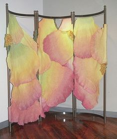 A handmade felt screen which works in a corner or as a room divider. It was made of dyed, unspun wool and yarns by Sharron Parker, It was ba...