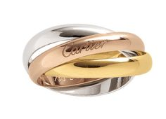 Cartier masters flawless elegance with these timeless bands. yellow, rose, and white gold Trinity rings by Cartier, Featured In: Golden Wedding Bands Gold And Silver Rings, White Gold Wedding Bands, Beautiful Wedding Rings, Silver Wedding Rings, Engagement Rings For Men, Rose Gold Engagement Ring, Designer Engagement Rings, Bague Trinity Cartier, Cartier Wedding Bands
