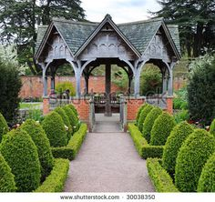 stock photo : Formal English Garden area with Summerhouse seating area