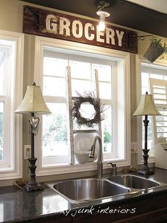 Cute idea of making my own vintage looking sign...also love the ladder on the windowsill above the sink....cute place to hang towels and dishrag :)