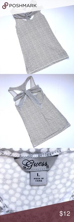 Guess Gray Polka Dot Tank with Racer Back This tank is so adorable! Light gray with white polka dots, in a super buttery soft material. The back is what really makes this top: it features a racer back style with a really pretty chiffon tie in the back. Size large Guess Tops Tank Tops