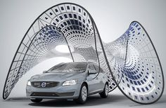 portable solar powered pavilion by volvo charges the electric V60 & folds up into the trunk for storage