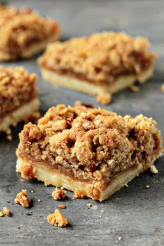 Apple Pie Bars - start with a rich, buttery shortbread crust that is topped with a layer of tart apples that are beautifully accentuated by a perfect blend of autumnal spices. To make these already incredible bars even better, a layer of sweet and nutty crumble adds just the right amount of crunch.