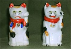 Maneki Neko - Seto - Painted Porcelain. Circa Early to Mid-20th Century. Two Examples from Slightly Different Molds.