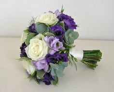www.fioribylynne.co.uk very subtle and pretty, a lovely posy for a purple wedding theme.