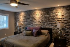 add value and coziness to any bedroom by adding a veneer stone accent wall.