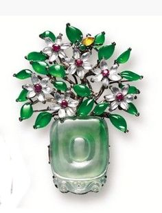 MULTI-COLOUR JADEITE, GEM-SET AND DIAMOND 'SPRING' BROOCHE.  Set with a jadeite plaque of celadon tone carved as a vase, flower blossoms set with jadeite, icy jadeite, yellow jadeite, ruby, orange sapphire and tsavorite garnet, symbolising 'spring';