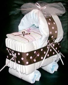 Diaper Bassinett. Change ribbon for gender or theme. Need: pins, pacifiers, ribbon, receiving blanket.