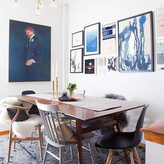 25 Of The Most Insanely Beautiful Rooms On Instagram #refinery29  http://www.refinery29.com/instagram-room-decor-inspiration#slide-5  A gallery wall in blue hues makes this dining room a standout....