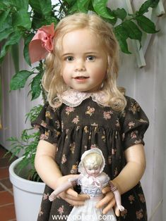 Sissel Bjorstad Skille Collectible Dolls.  Real hait & holding her own doll.  I just wanna hug her.....