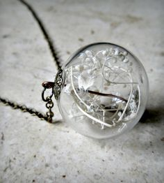 Glass Orb Dried Baby's Breath Terrarium Pendant   This countryside-inspired piece features a 25 mm glass orb bea...   Necklaces