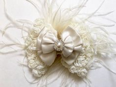 Ivory Rosette Feather Bow Fascinator at my Etsy shop https://www.etsy.com/listing/250503565/ivory-rosette-feather-fascinator-hair