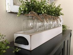 This is a 25 long (with handles) mason jar centerpiece. The jars can be painted or left clear and it can include the whispy boxwood or hydrangeas. The box can also be customized, scroll through the listing to see all of your customization options. I ship priority with tracking