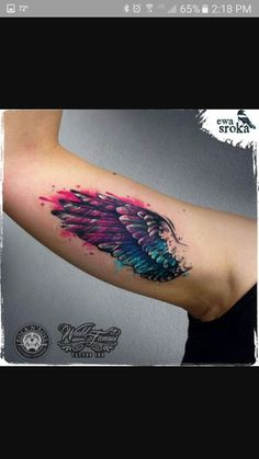 Watercolor wing tattoo