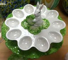 grey bunny in the center of the dish playing in the cabbage,
