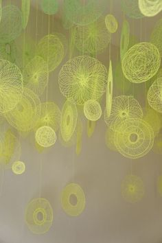 Textiles artist Amanda McCavour creates air suspended installations using repeated stitching and free embroidery on dissolvable fabric.
