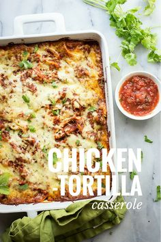 A cheesy chicken casserole with layers of tortillas and Cacique Cheese
