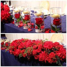 鮮やかな赤い花をメインにグリーンは少なめにとオーダーされた高砂装花。ご新婦さまの一番のこだわりは、水中花とキャンドルとのこと。ご新郎さま側へ4本、ご新婦さま側へ4本の計8本の水中花を飾られたそうです。