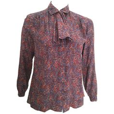 Salvatore Ferragamo 80s Silk Paisley Blouse Size 6. | From a collection of rare vintage blouses at https://www.1stdibs.com/fashion/clothing/blouses/ @1stdibs @Ferragamo #blouse #1980s #silk #paisley #fashion #vintage #forsale #shopping #style