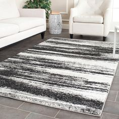 Recall mid-century modern style with this 6' x 9' rug from Safavieh's Retro Collection. Featuring an Art Deco inspired pattern of light and dark grey, this rug easily coordinates with most existing de