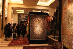 Guests view Zamani Collection's pop-up at the Four Seasons Beijing. (Surzhana Radnaeva)
