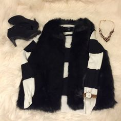⚫️ Mossimo Chic Fur Vest Never worn. Perfect condition! Mossimo Supply Co Jackets & Coats Vests