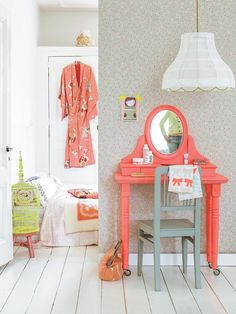 That's just too cute!  The colors are perfect!  And get this: you can move the table from underneath the mirror and use it somewhere else for a while.  Genius.