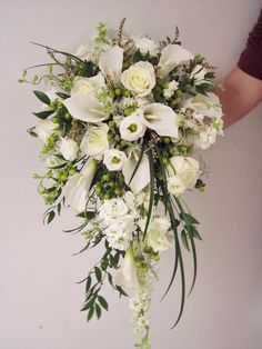 Cascade of mixed white flowers and greenery