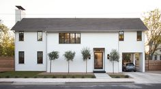 The exterior of this two-story home in East Austin, Texas was designed with a minimal palette, bronze windows, and steel details in order to blend into the existing cityscape.