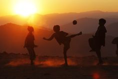 Boys play with a ball at sunset in Yansi village, Donhe township in the Naga Self-Administered Zone in northwest Myanmar December (Photo by Soe Zeya Tun/Reuters)