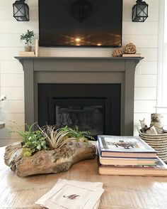 The fireplace surround is painted in Sherwin Williams Gauntlet Gray.