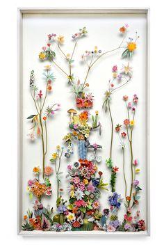 des fleur dans un cadre =une oeuvre d'art