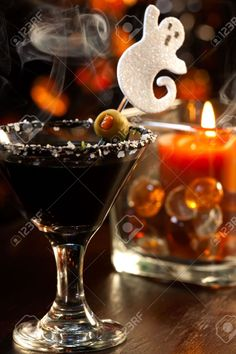 Scary Martini - Black Vodka, garnished with olive - silver skull on end of pick would be nice too.