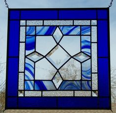 I handcrafted this stained glass window for a customer and can make a custom one for you with your choice of colors. This window measures 16 1/2 inches by 16 1/2 inches and can be made larger or smaller for you. There are 4 hangers soldered into each corner so that the window can be hung vertically or horizontally. This stained glass window panel is made of leaded glass. It is not copper foil. The panel is sealed with a traditional putty formula. This makes the panel stronger and mo...