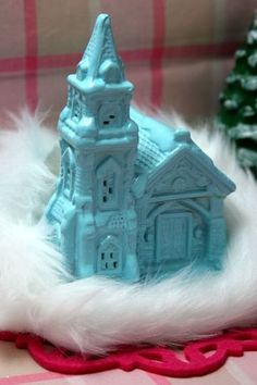 Paint dollar store holiday houses to fit your color scheme