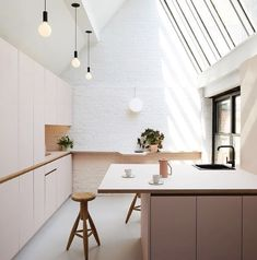 light and airy modern kitchen with awesome angled skylights