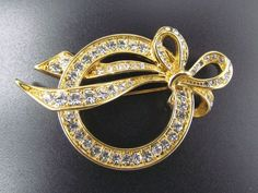 NOLAN MILLER Retired Round Cut Crystal Rhinestone Bow Gold Tone Brooch Pin