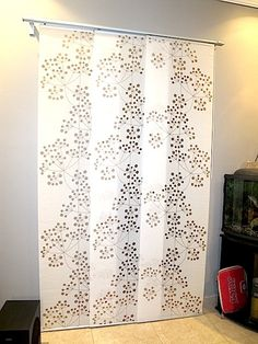 Ikea Panel Curtain with Kvartal rails (I plan on using these as doors for my closet and to cover my wood panel